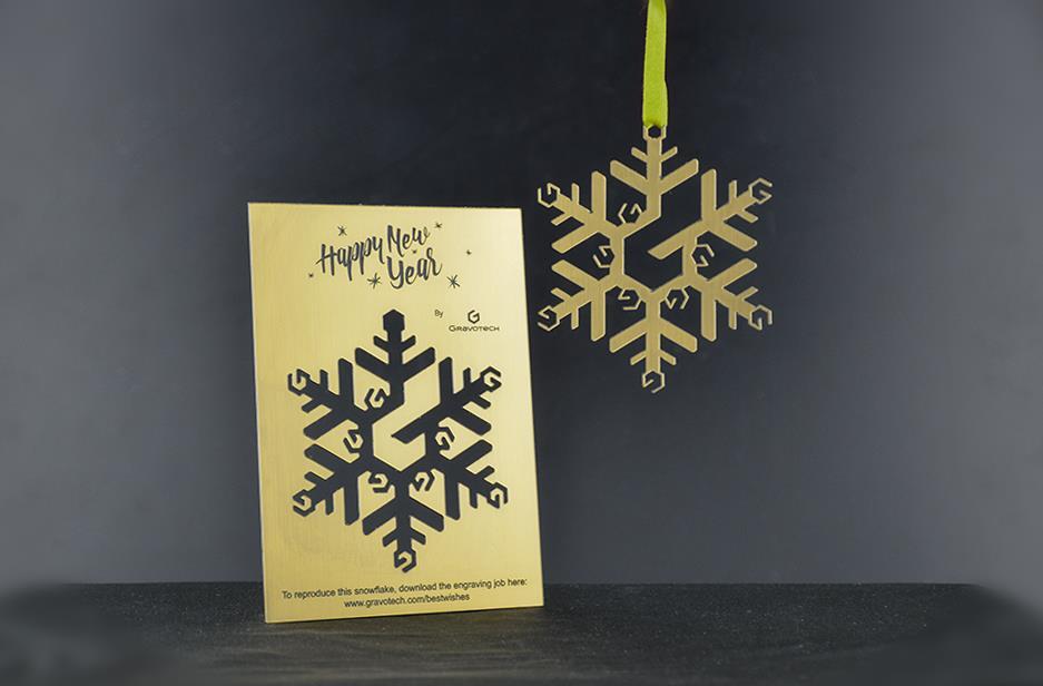 Graba y recorta tu copo de nieve navideño